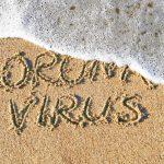 """Coronavirus concept. """"Stop Coronavirus"""" written on sand."""